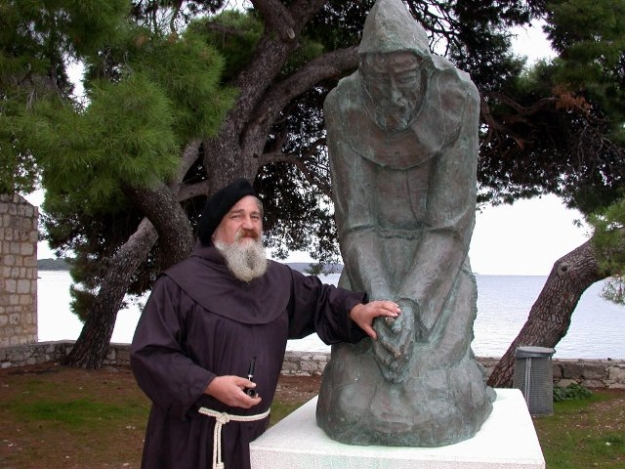 Fra Joakim Gregov with his statue of St. Francis of Assisi, in front of the Franciscan Monastery, Hvar